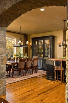 nice idea for creating separate spaces in larger space  love the arched stone