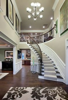 Love this entry way- date stairs with open two story living room- only I'd have…