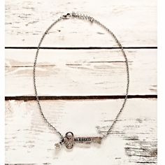 """Blessed Key Necklace  This silver pendent necklace features a key with """"blessed"""" etched on it and a hanging crystal. Jewelry Necklaces"""