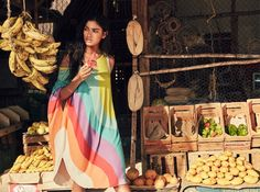 Rania Benchegra models a draped dress from Mara Hoffman's spring 2016 collection