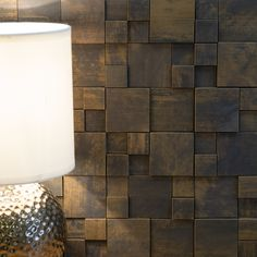 22 Ways To Tile Your Home & Top Tiling Tips | You might have avoided using tiles because visually they can appear cold. These mosaic tiles have acoppery metallic skinand atextured, multi-levelled split face surface. #metallictiles #tiledecor #homedecor #featurewall #coppertiles #tiles #interiors #interiorinspo #interordesign #walldecor #walls