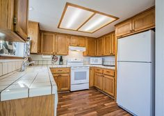 Kitchen includes: electric stove top, oven, dishwasher, microwave, coffee maker, and cooking basics