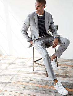 J.Crew men's Ludlow Traveler suit jacket and pant, button-shoulder cotton sweater in marled navy stripe and unisex Adidas® Stan Smith™ sneakers.