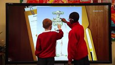 Students at a large interactive, multi-touch, multi-user display running Snowflake MultiTeach®.  For more information:  https://www.nuiteq.com/snowflake/software/multiteach/