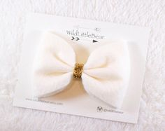 Beautiful handmade felt hair bow with a hint of sparkle at the center.  Bows can be attached to an alligator clip or a coordinating skinny elastic