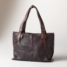 "ESSEX BAG -- A leather Italian zip bag that's going places, in rich, pebbled leather for an understated elegance. Two inner pockets, top zipper. Italy. Exclusive. Approx. 13-3/4""W x 4""D x 10""H."
