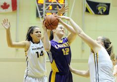 Wilfrid Laurier's Kim Yeldon is fouled as she tries to fight through the defence of University of Waterloo defenders Gia Spiropoulos and Sam McIntyre during the local barttle at UW on Wednesday. Wilfrid Laurier, Latest Breaking News, Defenders, Journalism, Newspaper, Wednesday, University, Sports, Hs Sports