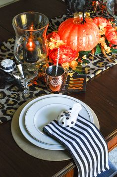 Glam Halloween table set with copper mugs, leopard print runner, dramatic orange and yellow florals, glass pumpkins, and spooky crows. Glass Pumpkins, Mini Pumpkins, Painted Pumpkins, Halloween Table, Halloween Diy, Pumpkin Centerpieces, Holiday Centerpieces, Table Place Settings, Autumn Table