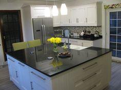 Beautiful Bespoke kitchen finished in Farrow u Ball White Tie with Star Galaxy granite and Oak interiors