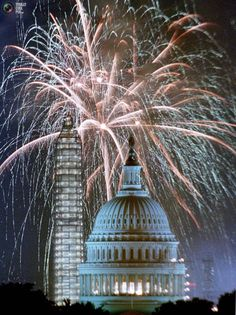 Fireworks light up the sky over the U.S. Capitol and the Washington Monument during Independence Day celebrations in Washington D.C. July 4, 1999. The U.S. celebrated its 233rd birthday.
