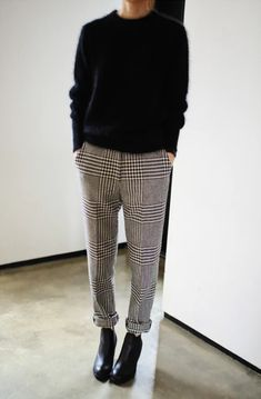 Plaid trousers, black sweater, high-heeled boots