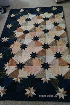 mmm quilts: Hunter's Star variation. Love the border. Colour and luminosity ideas good...