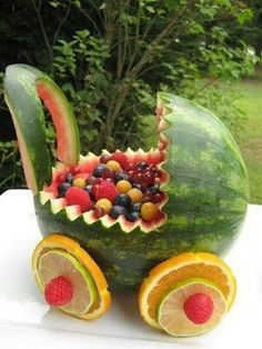 watermelon baby carriage fruit basket photos to show you how easy it is to make a watermelon baby buggy Watermelon Fruit Salad, Watermelon Carving, Fruit Salads, Fruit Snacks, Fruit Bowls, Watermelon Basket, Watermelon Animals, Watermelon Images, Watermelon Decor