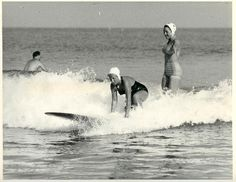 Girls surfing in the 1940s