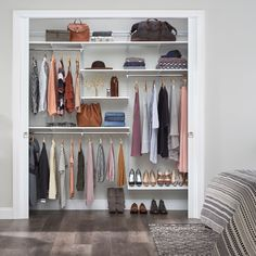 Repin this photo if adjustable wood shelving for your closet belongs on your wishlist this year. Featured: ShelfTrack EVO; available exclusively from Authorized Dealers #ClosetDesign #HomeOrganization #BedroomCloset