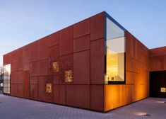 Studio Farris adds Corten extension to a library in Bruges  This library extension in the centre of Bruges is covered in sheets of pre-rusted Corten steel, deliberately contrasting the white plasterwork of the original building