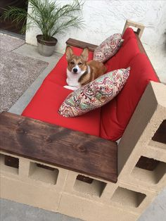 Cinder block outdoor couch with a little paint, stained wood armrests and some corgi action :) Diy Patio Furniture Cheap, Pallet Patio Furniture, Patio Furniture Cushions, Modern Outdoor Sofas, Outdoor Couch, Outdoor Living, Cinder Block Furniture, Cinder Blocks, Paint Stained Wood