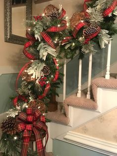Christmas garland for staircase flocked greens pine cones grapevine balls plaid ribbon www marysflowerworks com Christmas Staircase Decor, Elegant Christmas Decor, Diy Christmas Garland, Christmas Towels, Christmas Mantels, Noel Christmas, Rustic Christmas, Christmas Themes, Silver Christmas