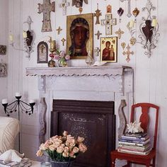 Collection of religious icons and other items on wall above fireplace Source: Apartment Therapy Catholic Altar, Catholic Relics, Prayer Corner, Home Altar, Beach Bungalows, Religious Icons, Religious Art, Religious Images, Prayer Room