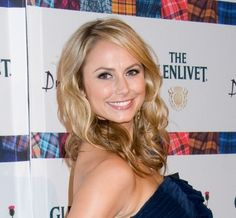 Stacy Keibler wears a side-swept hairstyle