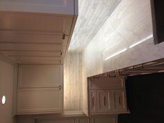 White Dove kitchen cabinets and Calcutta marble counters