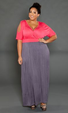 4576da5b424 Color block- chic comes to life in this comfortable plus size maxi dress.  Peekaboo cold-shoulder details give this maxi extra style.