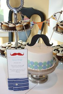 I love this! Mustache party with a mustache cake and cupcakes!! <3