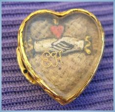 Stuart Crystal, Heart, Hands, Hands lay on a bed of woven hair. Ancient Jewelry, Antique Jewelry, Vintage Jewelry, Memento Mori, Stuart Crystal, Mourning Jewelry, Mourning Ring, I Love Heart, Sacred Heart