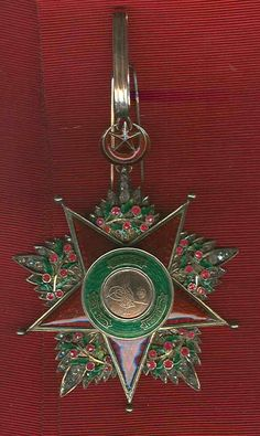 Turkey Ottoman order of Sevkat Grand Officer neck badge in superb condition, set in diamonds and rubies and GOLD