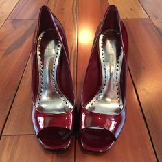 BCBG Ruby Red Ariel Shoes Ruby red tumbled pearl patent leather open toe shoes.  These put Dorothy's to shame. Absolutely beautiful shoe! Worn one time. True to size. BCBGeneration Shoes Heels