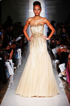 Gold infused white gown that flows and shines with every move. Perfect for the runway or a formal event .