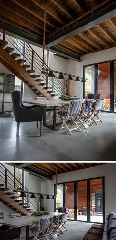 This dining area features a wood table with a steel base, and above the table, industrial inspired lighting hangs from rope attached to the ceiling. #Industrial #IndustrialInterior #DiningRoom #DiningArea