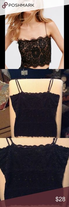 GORGEOUS BLACK LACE DAYTRIP CAMI TOP THIS IS A GORGEOUS CAMI/TOP IT HAS ADJUSTABLE STRAPS AND FULLY LINED IN THE FRONT SO YOU CAN WEAR IT TO BE SEEN WITH A FLOWY OPEN KIMONO OR CARDIGAN Free People Tops
