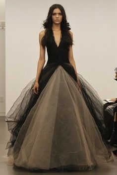 Love that she does something different . Black wedding dress is something I would wear for my wedding .