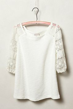 own this one. Love the lace sleeve detail. Just wish it was a little warmer. The ivory is a little bright for me.