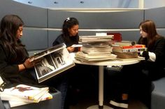 Students at work today in the UCA Epsom Library pods: notice the tower of books!