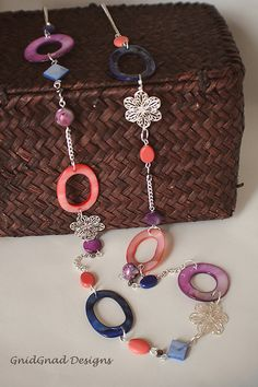 Handmade Summer Necklace at www.GnidGnadDesigns.etsy.com. Coral, Purple, Blue Mother of Pearl, Filigree Flower