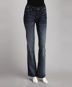 Handcrafted for a unique look and feel, these high-quality low-rise flare jeans are a canvas for personal style. Fading in front and back helps contour the silhouette. while distressed elements enhance the worn-in design.