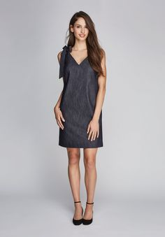 Ashley is an easy to wear summer sheath dress. Made out of Italian stretch  denim, it's as comfortable as it is chic.  Made in Canada. Hand wash and lay flat to dry, dry cleanable.      * 82% Cotton     * 17% Silk     * 1% Elastane