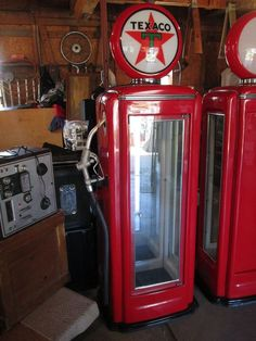 "Texaco gas pump display case (new). Retails for over $2,000. Fiberglass construction. Glass door and glass side. Other two sides are mirrored. Has three adjustable shelves and two lights (globe and interior cabinet). 6'2""T including globe, 24""Wx18""D."