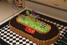 The race car cake with oreo crumb track, grahm cracker stick siding ...