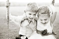 flower girl and ring bearer on wood tree swing | mayowood stone barn wedding | photo: www.angelicjewelphotography.com