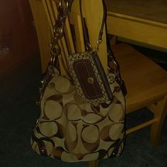 Coach Large Carly & Matching Wristlet Good,used condition has,some wear as noted in picture 3 at the top. Lining in very good condition. Khaki with brown Cs gold hardware. Offers are welcome. Coach Bags Hobos