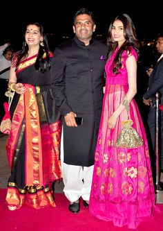 Suniel Shetty with wife Mana and daughter Athiya at Arpita Khan's wedding reception in Mumbai. #Bollywood #Fashion #Style #Beauty #Handsome