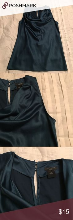 Ann Taylor peacock sleeveless top Ann Taylor peacock color silky top. Sleeveless. Size 2p. Has small snags in the front, please see photos Ann Taylor Tops Blouses