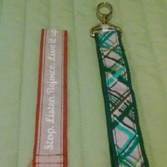 2 Thirty-one key fobs 1. Tan and Red with inspirational words. 2. Grey and blue striped, clip on one end. Smoke free home. Price is for both together, will separate. Thirty-one Accessories Key & Card Holders