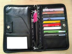 Inside the Timeless Wallet!  This Wallet Is Great It has enough room for your Check Book, Credit Cards, you would have to see it to believe.
