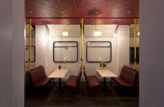 Wine bar Cellar Magneval in Fleet, Hampshire, UK. Featuring   London bus seating
