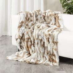 32992bb94b Dress up your favourite room in the house with our Natural Brown Rabbit Fur  Blanket.