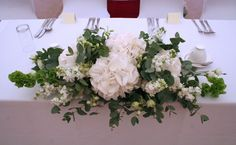 White and green top table, elegant simplicity. White hydrangea and stocks, with eucalyptus